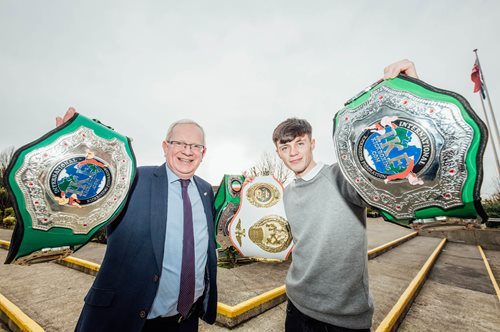 Limerick Kickboxer Tyrone Cronin with LIT President Vincent Cunnane pictured today as 56 international athletes received the Limerick Institute of Technology Sports Scholarship this academic year.